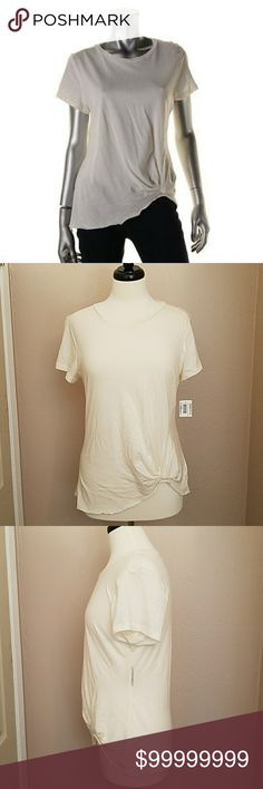 """💥MAISON JULES💥TWIST FRONT TEE A modern TWIST to the everyday boring tee👕~ Maison Jules Ivory, twist knot front, short sleeve t-shirt. 💛  Total Length Longest Approx. 26""""/Shortest (knot) Approx. 22""""...60% cotton 40% modal.  A FUN, fashion forward staple to update your wardrobe❗🤗 MAISON JULES  Tops Tees - Short Sleeve"""