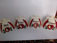This is a vintage Purinton Slip Ware canister set in the popular Apple pattern. There are four canisters, one for Flour, one for Sugar, one for Tea