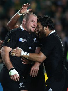 Tony Woodcock Photos Photos - Tony Woodcock of the All Blacks celebrates scoring their first try  with team mate Piri Weepu during the 2011 IRB Rugby World Cup Final match between France and New Zealand at Eden Park on October 23, 2011 in Auckland, New Zealand. - France v New Zealand - IRB RWC 2011 Final