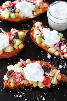 Greek Stuffed Sweet Potatoes Baked sweet potatoes topped with chickpeas, tomatoes, cucumber, kalamata olives, red onion, feta cheese, and tzatziki sauce. These loaded sweet potatoes make an easy, healthy, and delicious meal!