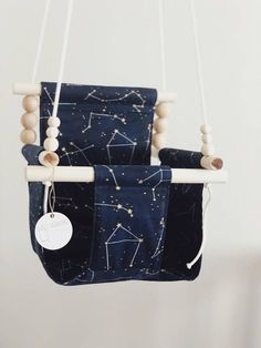 This baby and toddler swing is a unique way to enjoy some fun with your little one! Play indoors when the weather is cold and outdoors when the weather is warmer! Baby must be able to sit unsupported to use our swings. Space Themed Nursery, Nursery Themes, Outer Space Nursery, Baby Must Haves, Constellations, Baby Shower Gifts, Baby Gifts, Indoor Swing, Indoor Outdoor