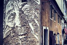 vhils  Using a slow archaic method of chipping away at surfaces street artist, Vhils, creates striking portraits with meticulous detail only subtle chips can create. This newest work of his is located in Lisbon, Portugal.