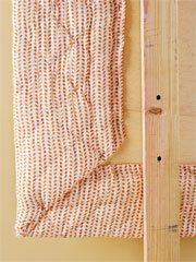Make an upholstered headboard out of an old comforter - omg freaking genius!!!!!!