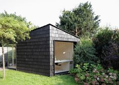 Every inch of this tiny backyard studio serves a purpose: as office, sleeping quarters for guests, and bike storage shed. Read on to see how Amsterdam-based architect Serge Schoemaker accomplished it all in 323 square feet: