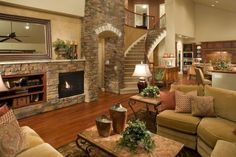 stone accent wall and archway in living room next to staircase