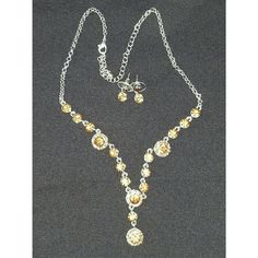 NWOT Necklace and earring set NEVER WORN Beautiful golden colored stones will grace your neck while matching earrings adorn your ears. Purchased and never used. From a pet and smoke free home.  Please ask any questions you may have before you buy. Jewelry Necklaces