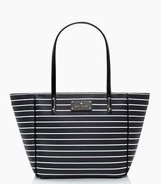 """Kate Spade New York City Stripe Small Sidney Tote, Navy / Cream. Printed grainy vinyl with flat color patent trim. 9.8""""W x 9.4""""H x 7""""D; 8 1/2"""" strap drop - dog clips adjust width of bag. Open top. 14-karat light gold plated hardware. Custom-woven quick and curious lining with zip, cellphone and multi-function pockets."""