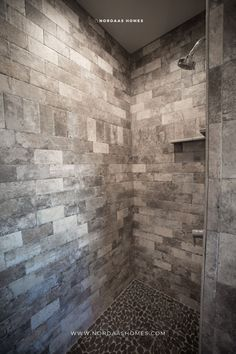 A stunning rustic brick wall in this walk in bathroom shower adds the perfect rustic design touches to this custom bathroom. Contact us if building new or remodeling for your custom design. Bathroom and home designed and built by Nordaas Homes. Modern Farmhouse Bathroom, Classic Bathroom, Farmhouse Design, Rustic Design, Bathroom Styling, Bathroom Interior Design, Interior Ideas, Walk In Bathroom Showers, Bathrooms