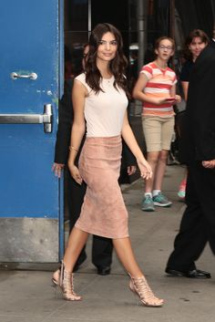 Emily Ratajkowski wears a Brunello Cucinelli blush-tone suede skirt, Atea Oceanie pale pink tee and rose gold strappy sandals