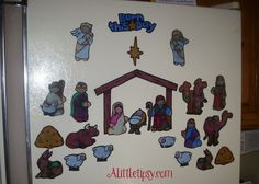 DIY Magnetic Nativity Advent (alternatively, put stickers on a magnetic sheet and cut out)