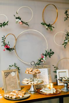 simple and beautiful gold embrodery hoop and flower dessert table backdrop