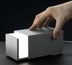 Box Light is a lamp that can be manually adjusted by sliding the box open or closed. Designed by Jonas Hakaniemi.