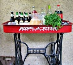 Radio Flyer Wagon repurposed :: Little Red Wagon :: old and vintage sewing machine :: Singer iron base :: combining Grandmother's machine with Mom's toy :: Party idea :: drink station inspiration Redo Furniture, Decor, Home Diy, Sewing Cabinet, Decorating On A Dime, Furniture, Old Sewing Machines, Repurposed Furniture, Home Decor