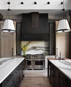 and my life's lookin' up' This pale wood adds so much magic to this double island kitchen.and symmetry gets me every time.that marble, tho. Beautiful Kitchen Designs, Best Kitchen Designs, Beautiful Kitchens, Kitchen And Bath, New Kitchen, Kitchen Decor, Kitchen Ideas, Black Kitchens, Cool Kitchens