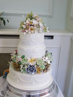 Beautiful unique wedding cake with royal icing and sugar flowers