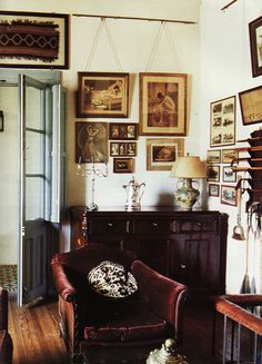 mix of antique prints, photos and furniture, plus that great vintage chair