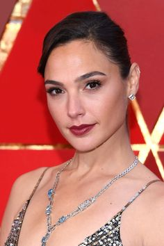 2018 Oscars - Gal Gadot  Wonder Woman and the face of Revlon looked stunning in a French twist and raspberry red lipstick