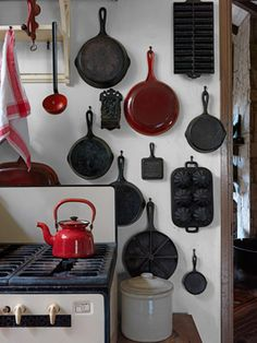 Cookware Collection, who needs a backsplash? Love this look and simplicity! Of course adore vintage stove!