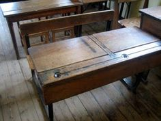 school desks with ink wells - I sat at desks like this in primary school - steel nibbed pens with a wooden handle which left blobs of ink on the exercise book and white ceramic ink wells. Ah those were really awful school days !