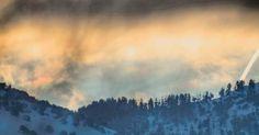 Glowing Sunrise with a little rainbow #mountains #cachevalleyutah #light #sunrise #rainbow