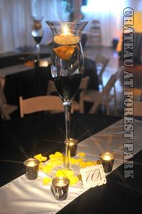 Tall vase with black beads, real yellow rose & floating candle. They designed arrangment #2 and I loved it!