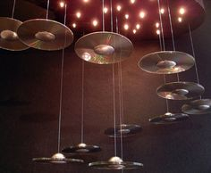 flying saucer mobile made out of old CD's and ping pong balls