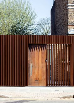 BuildingWeathered steel louvres screen a hidden house in Hackney by Guttfield Architecture Tor Design, Facade Design, Fence Design, Architecture Today, Facade Architecture, Contemporary Architecture, Front Gates, Entrance Gates, Hidden House