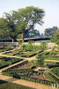 Boxwood-edged parterres define the kitchen garden | archdigest.com