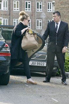 "Adele in Gucci Sunglasses and Jimmy Choo ""Rosabel"" Leather Handbag 