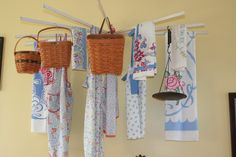 Vintage laundry drying rack.  I wonder if I could hang something like this in the basement.