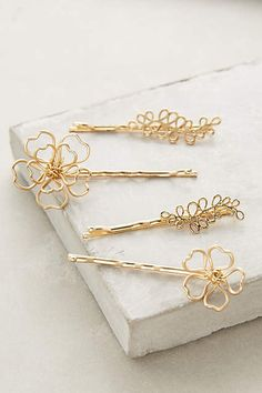 Inspiration for all those lost earrings that you now only have one of, or broken necklaces with charms and pendants floating around. Make adorable hair pin. OR purchase these Copper Blossom Bobby Set - anthropologie.com