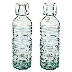 Set of two recycled glass hermetic bottles.  Product: Set of 2 bottlesConstruction Material: Recycled glass, rubber, plastic and metalColor: ClearFeatures:  Can be used for serving ice tea, lemonade or water68 Ounce capacity each  Dimensions: 12.5 H x 4.6 Diameter eachCleaning and Care: Hand wash