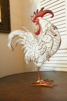 A white metal rooster