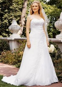 An elegant but not run-of-the-mill wedding dress with princess cut beaded lace bodice, oh so flattering chiffon side drape and split front. A Chapel train and enticing lace up back.