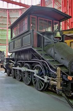 A camelback locomotive (also known as a Mother Hubbard or a center-cab locomotive) is a type of steam locomotive with the driving cab placed in the middle, astride the boiler. (Wikipedia)