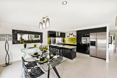 #Dining #room #ideas from Ausbuild's Segal display #home.This room is bright and airy with a colour palette of white, black, and green. www.ausbuild.com.au