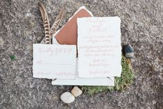 Wedding invitations - by Sincerely Amy Designs  Calligraphy - leather lined envelopes - copper ink - feathers rocks and moss  Styled by Wright Event Services  Photography: Andrea Pesce Photography - www.andreapescephoto.com  Read More: http://www.stylemepretty.com/2015/02/23/earth-wind-fire-water-styled-wedding-inspiration/