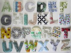 Baby patchwork quilt with letters appliqued on.... great idea to cut them round with pinking shears