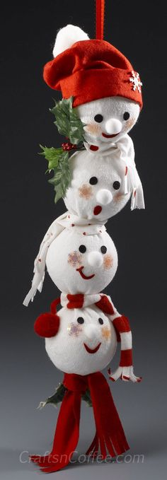 DIY How to Make a Sock Snowmen - these would be so cute to hang on a Christmas tree, on a door handle, in a doorway, etc...
