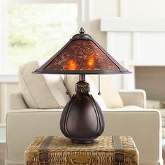 From our best-selling Tiffany-style lamps assortment comes this stunning bronze pottery table lamp with a mica mineral shade.