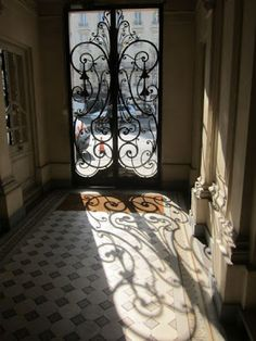 here is a way to use strong sunlight to enhance the image. Lets make the shadows work for us....Parisian Entry