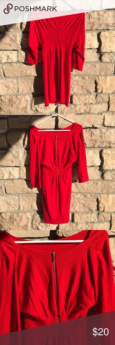 Express Red sweater Dress🎩. Express Red sweater Dress🎩. Good preowned condition!  40% nylon, 30% rayon, 30% Wool. 3/4 sleeve, elastic at waist, exposed back zipper. I'm selling this great dress for a friend! Express Dresses