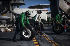 SOUTH CHINA SEA (Nov. 14, 2013) Sailors roll tires onto a C-2A Greyhound from the Providers of Fleet Logistics Support Squadron (VRC) 30, Detachment 5, on the flight deck the U.S. Navy's forward-deployed aircraft carrier USS George Washington (CVN 73). The George Washington Carrier Strike Group is en route to the Republic of the Philippines to support Operation Damayan, the humanitarian efforts in response to Typhoon Haiyan/Yolanda. (U.S. Navy photo by Mass Comm Spec Seaman Liam Kennedy)