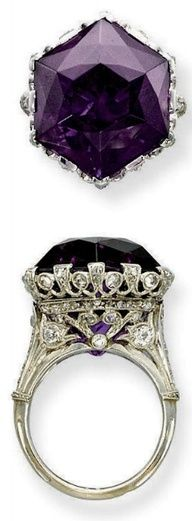 A BELLE ÉPOQUE AMETHYST AND DIAMOND RING. Set with an hexagonal amethyst to the openwork millegrain diamond-set gallery and half-hoop, circa 1915, with French assay marks for platinum and gold.