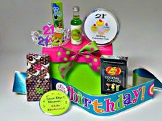 She only turns 21 once! This 21st Birthday Chick Kit is just adorable!! Contains 21st Birthday Cake,   Cocktail Flavored Jelly Beans, Brownies, 21st Birthday Sash, Too Fun 21st Birthday Crown, Hello Bartender, Good bye Bouncer Pin and choice of drink mixers (margarita or martini). $39.95
