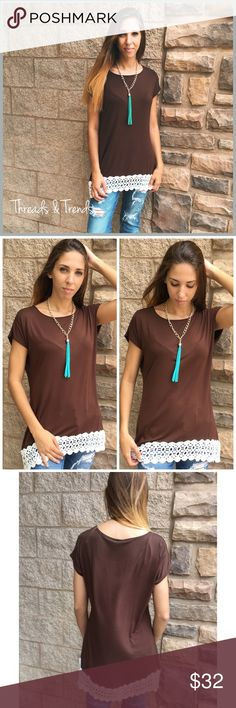 "Chocolate Crochet T-Shirt Chocolate brown tee featuring a lace crotchet hem. Perfect transitional tee for the fall. Made of a rayon and spandex blend. Sizes S,M, L.                                   S Bust 50 Length 31  M  Bust 54"" Length 32  L Bust 58 Length 31. Grey Tops Tees - Short Sleeve"