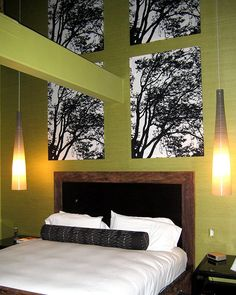 bedroom design with bold interior paint color and artwork