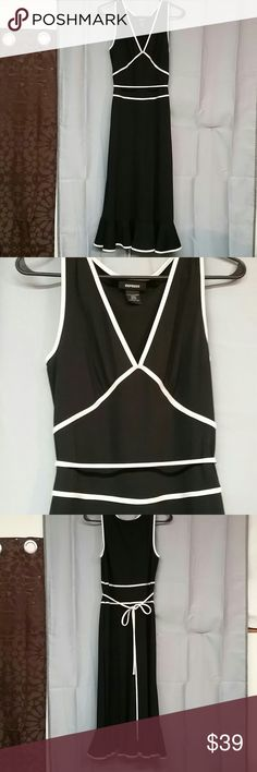 Express dress size 9/10 Sexy black and white dress size 9/10 100% polyester cute tie around the waist ruffle at the bottom Zips down the side sleeveless measurements laying flat or armpit to armpit length from shoulder down is 47 inches Express Dresses