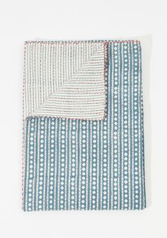 This hand-quilted blanket is not only beautiful but extremely soft and comfortable. The distinct diamond pattern is made from hand-blocked layers...