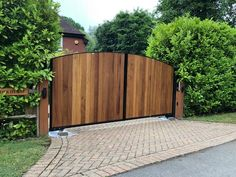 Our Kent design metal framed driveway gate with hardwood Iroko timber infill. Metal Driveway Gates, Driveway Entrance, Fence Gate, Electric Gates, Gate Ideas, Craftsman, Hardwood, House Ideas, New Homes